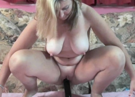 Liisa plays with her big black dildo